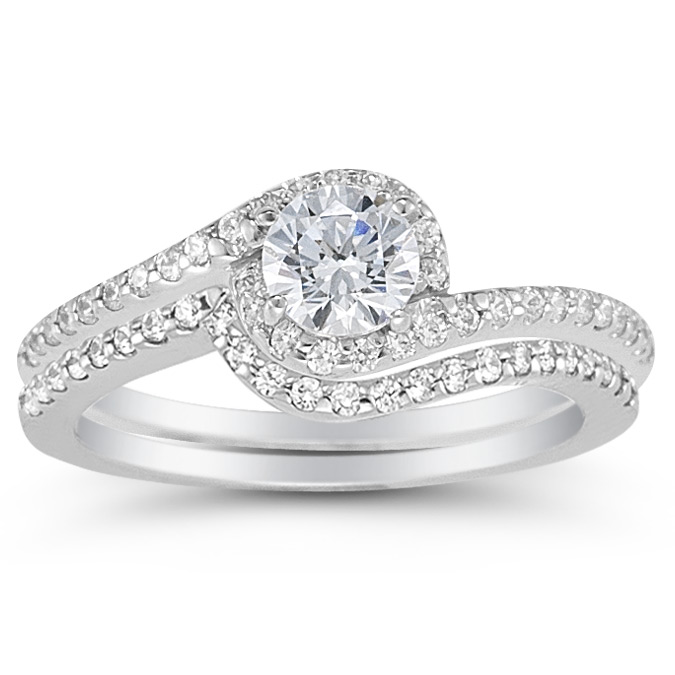 engagement ring is a top choice this year not only because its simply stunning but because it incorporates three prominent trends in wedding jewelry