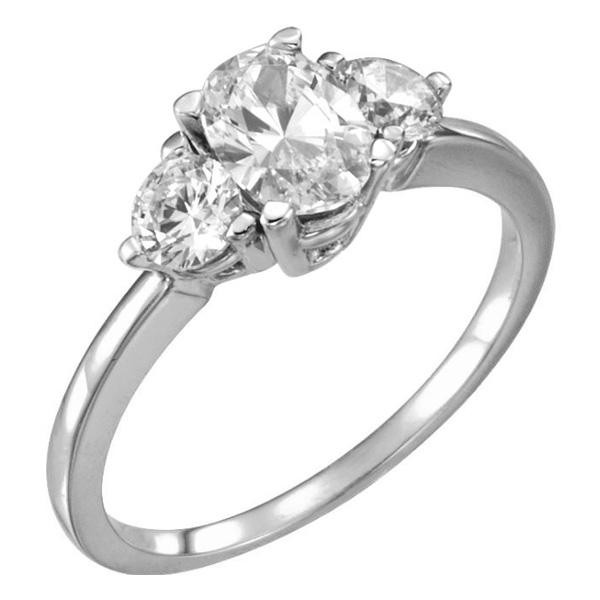 1.25 Carat Three-Stone Oval and Round Diamond Engagement Ring