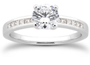 0.65 Carat Round and Princess Cut Diamond Engagement Ring