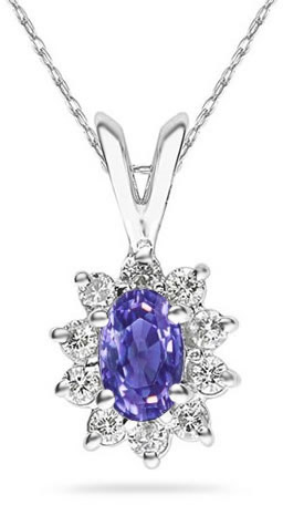 6mm x 4mm Oval Shaped Tanzanite and Diamond Flower Pendant in 14K White Gold