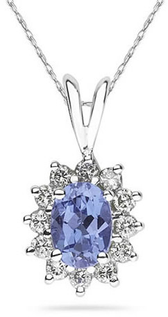7mm x 5mm Oval Shaped Tanzanite and Diamond Flower Pendant in 14K White Gold
