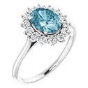 1.15 carat oval aquamarine and 1/3 carat diamond halo ring