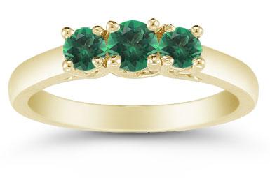 three emerald ring yellow gold