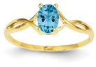 Oval Blue Topaz Birthstone Ring in 14K Gold