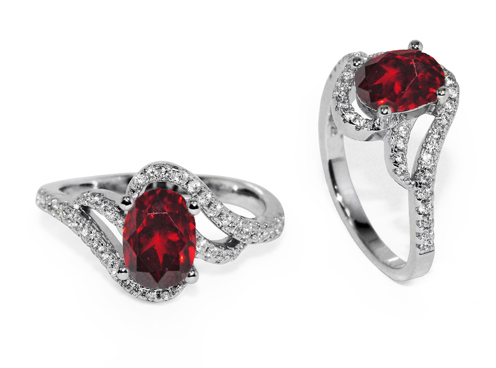 Oval Garnet and White Cubic Zirconia Ring in Silver