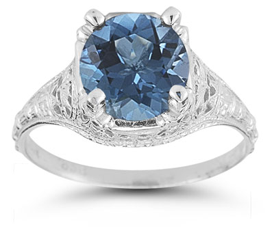 Antique-Style Floral Blue Topaz Ring in 14K White Gold