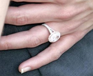 Katie Holmes engagement ring looks lovely with rose gold surrounding the diamond.