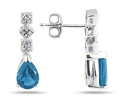 blue topaz and diamond swirl earrings white gold